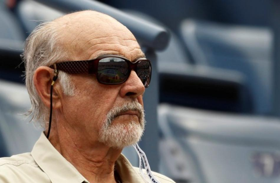 Actor Sean Connery watches from the gallery at the US Open tennis tournament in New York. REUTERS...