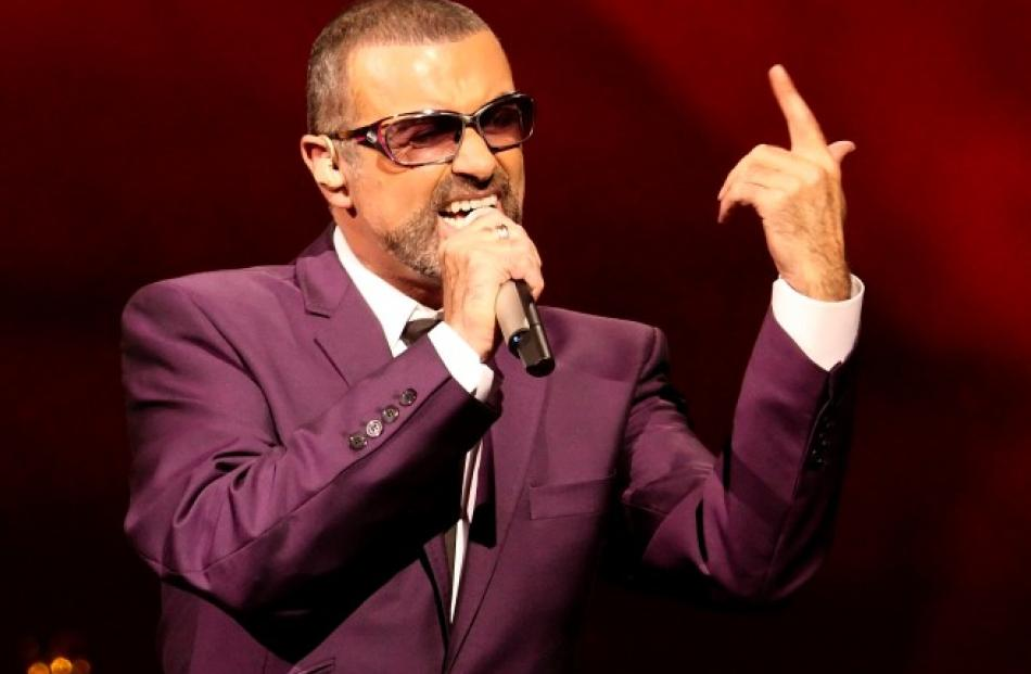 British singer George Michael performs on stage during his 'Symphonica' tour concert in Vienna....