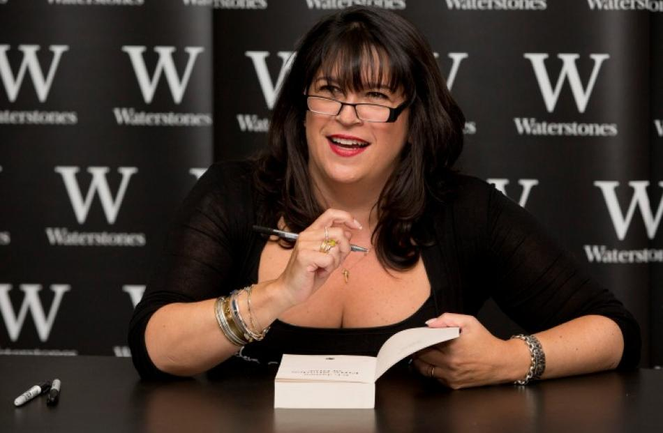 E L James, author of 'Fifty Shades of Grey', poses for photographers during a book signing in...