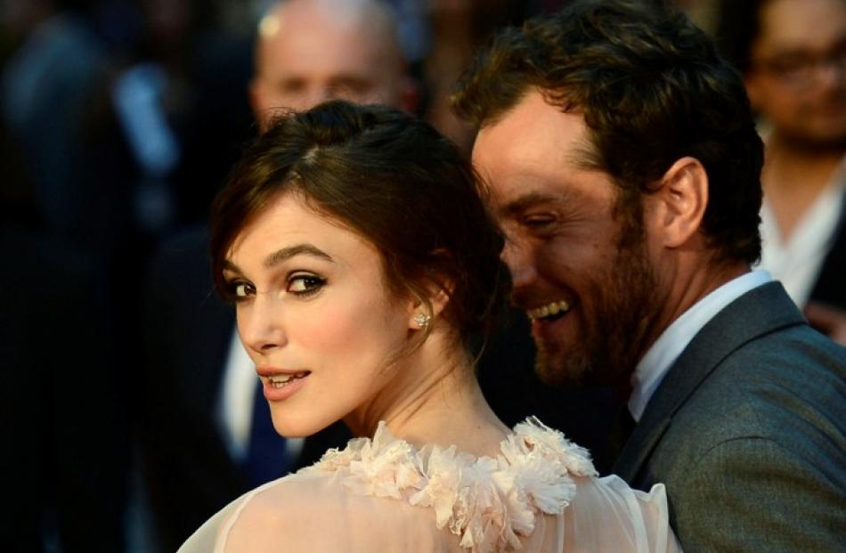 Keira Knightley (L) and Jude Law pose for photographers as they arrive for the world premiere of ...