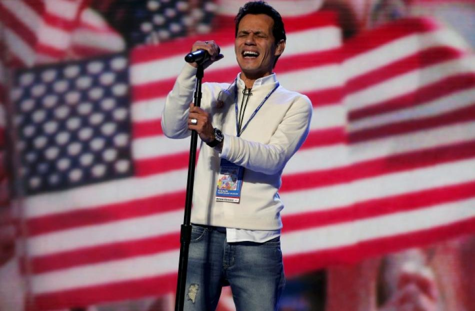 Singer Marc Anthony rehearses the national anthem before the final session of the Democratic...