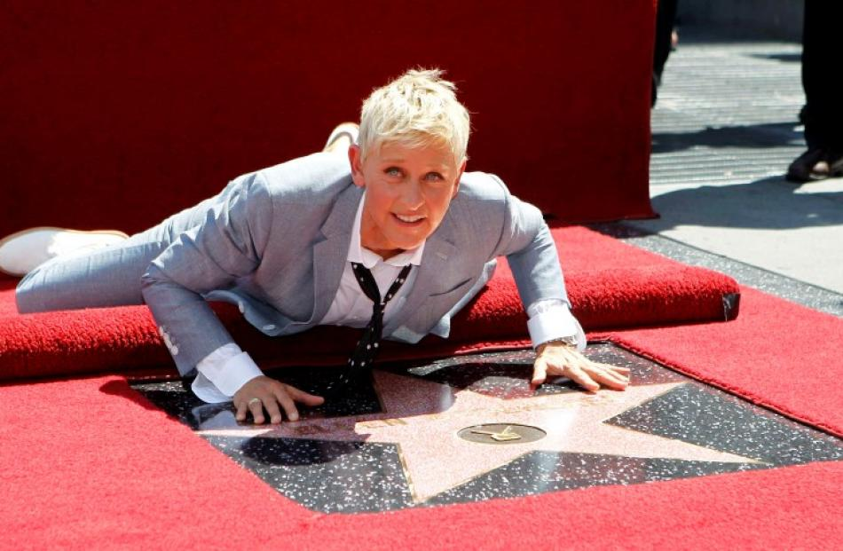 Television personality Ellen DeGeneres touches her star after it was unveiled on the Walk of Fame...