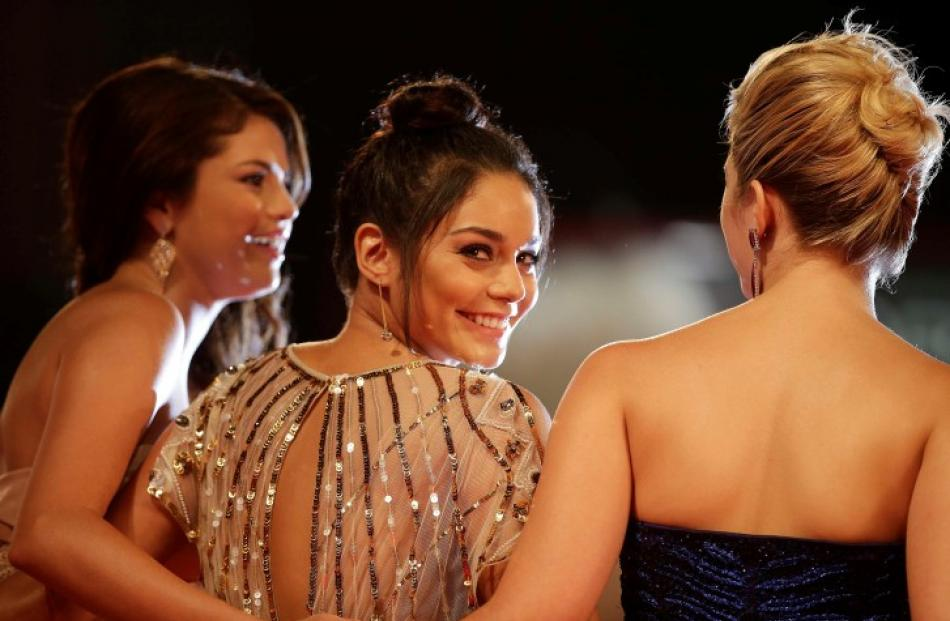 US actresses Vanessa Hudgens (C), Selena Gomez (L) and Ashley Benson pose on the red carpet...