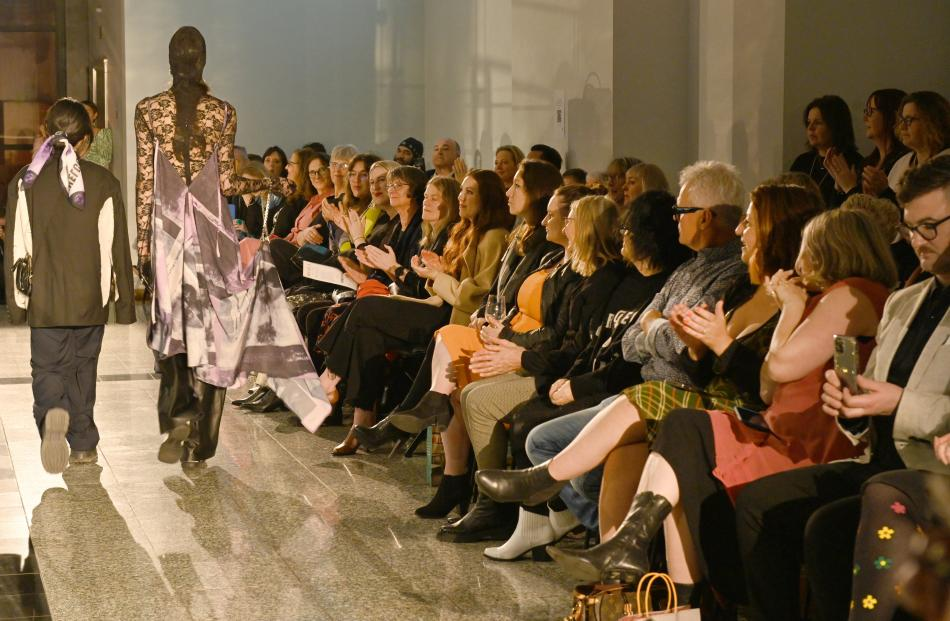 Onlookers clap designs of this year's iD International Emerging Designer Awards finalists. PHOTOS...