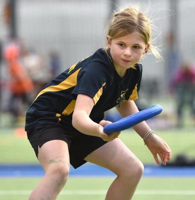 Evie Peddie (9), from Macraes-Moonlight School, gives it her all.