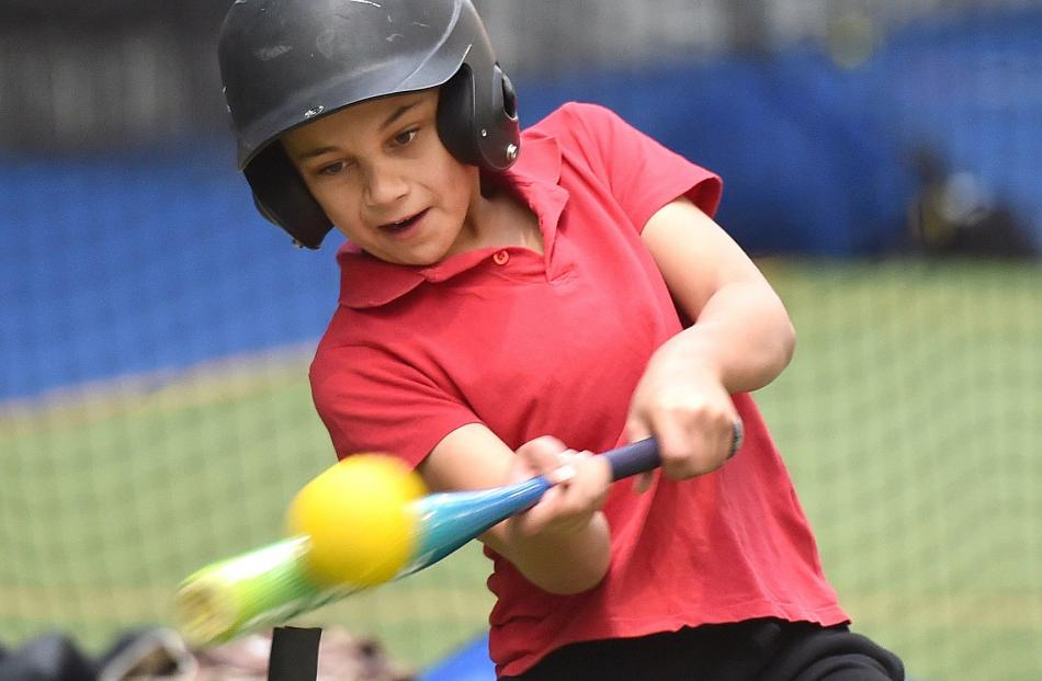Harlem George (10), from Palmerston School, hits a home run.