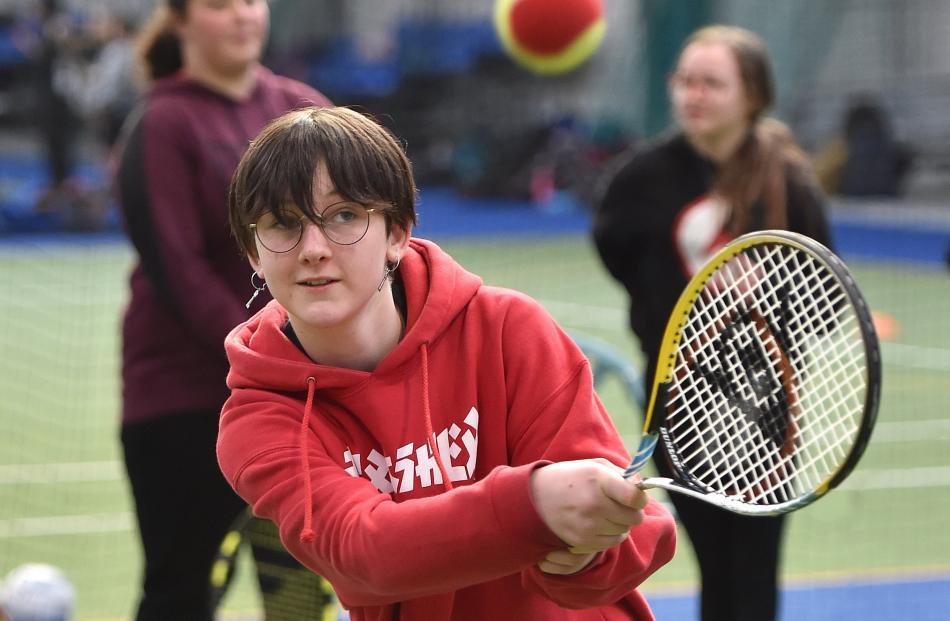 Max Ross (12), from Waitati School, smacks a return shot.