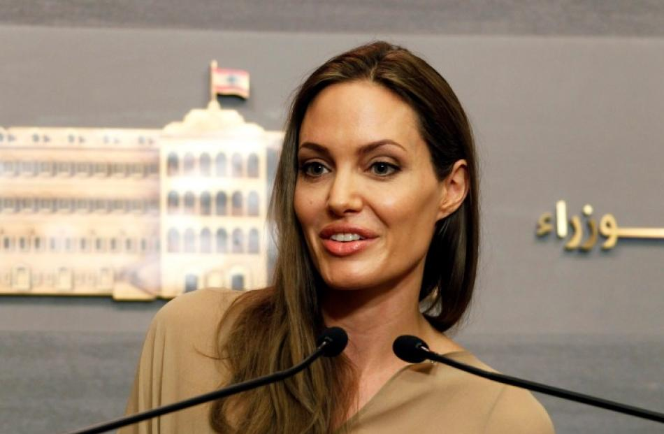 Actress Angelina Jolie, the UN refugee agency's special envoy, speaks during a news conference...