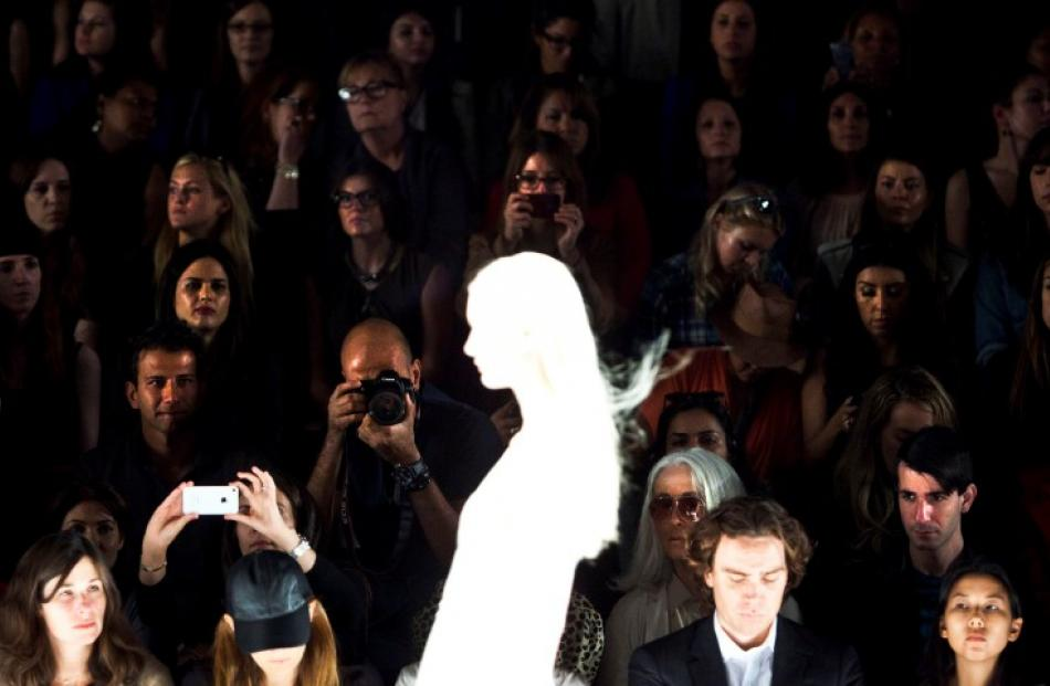 Audience members watch a model during the J. Mendel Spring/Summer 2013 show at New York Fashion...