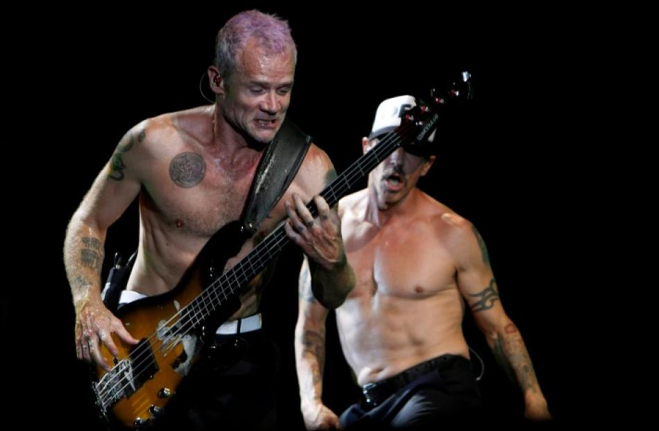 Red Hot Chili Peppers' frontman Anthony Kiedis and bassist Flea (L) perform during a concert at...