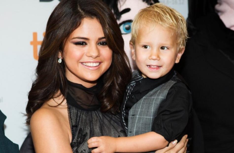 Selena Gomez holds Jaxon Bieber, Canadian singer Justin Bieber's little brother, as she arrives...