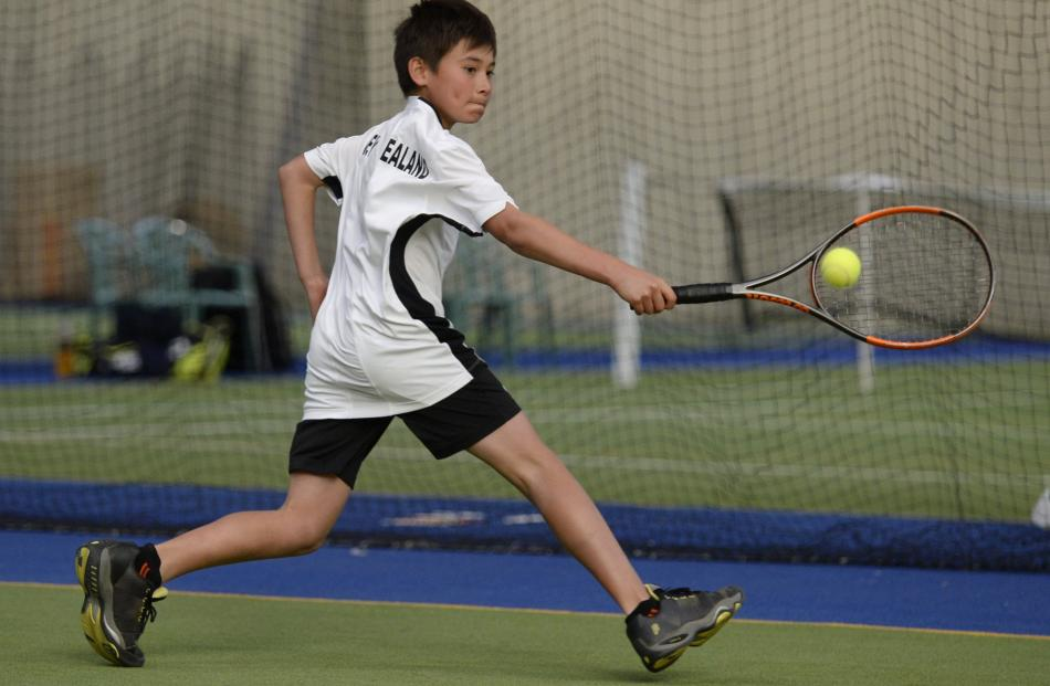 Auckland junior Raphael Savelli (10) in action during a first-round singles game.