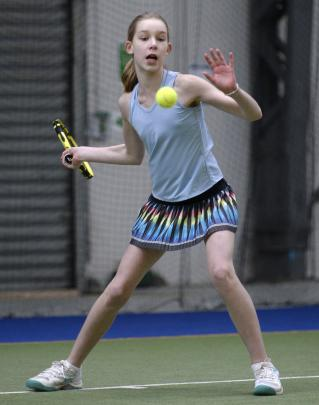 Chloe Rawlence (12), of Auckland, lines up a forehand.