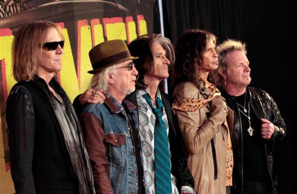 Aerosmith members (L-R) Tom Hamilton, Brad Whitford, Joe Perry, Steven Tyler and Joey Kramer...