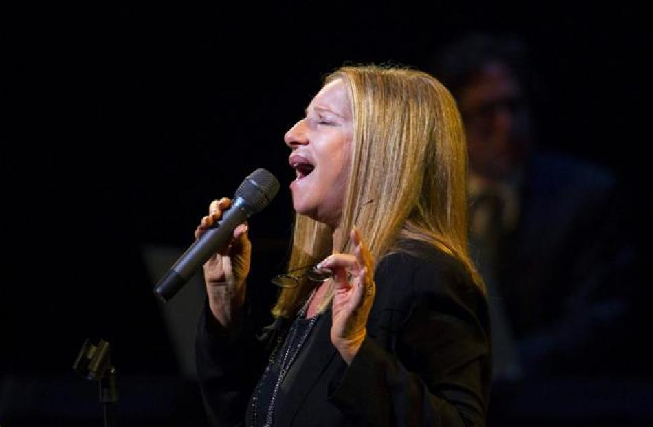 Singer Barbra Streisand performs during a tribute concert to composer Marvin Hamlisch in New York...