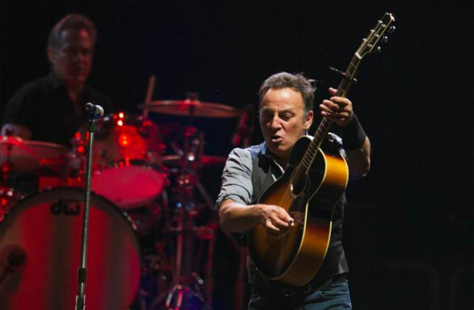 US musician Bruce Springsteen performs with the E Street Band during a concert in East Rutherford...