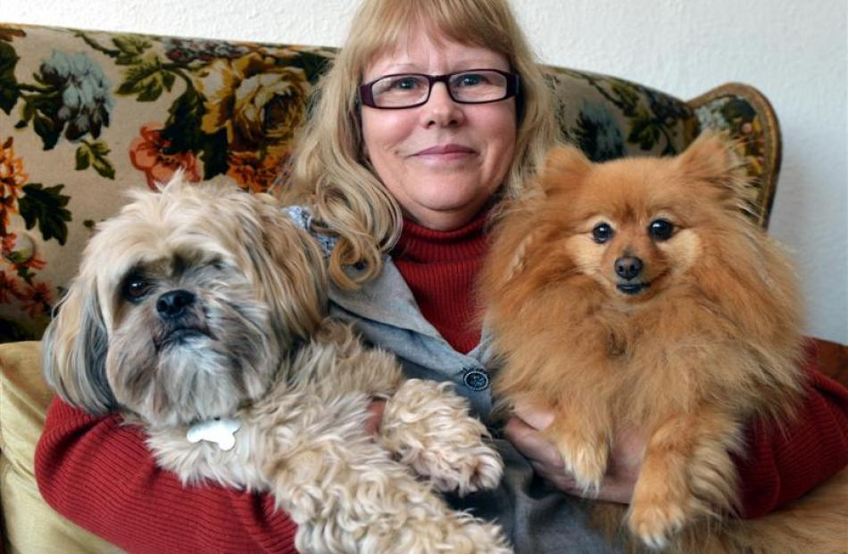 Patricia  Reid last night with two of her dogs, Ewok (left) and Mushka, whom she threw out of the...