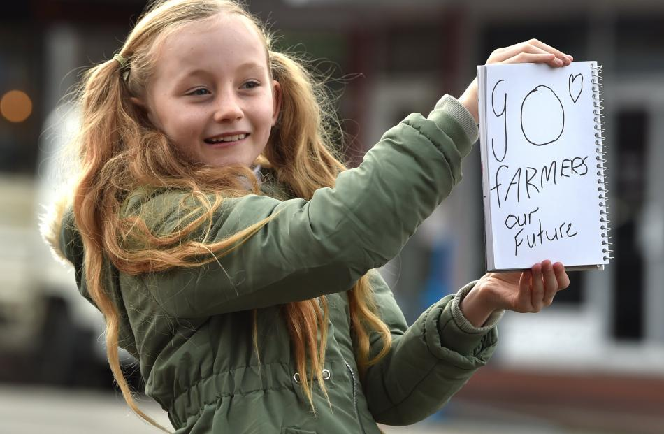 Maggie Smither-Clark (9), of Dunedin, shows her support for the Dunedin protest.PHOTO: CHRISTINE...