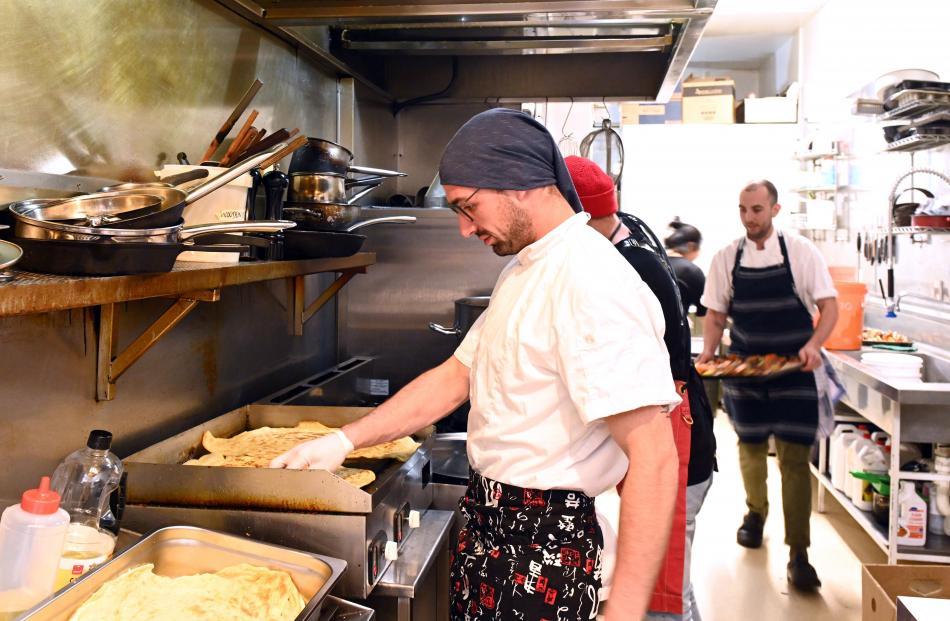 Chef Nicolo Mollica, from the Esplanade, prepares roti for the main course.