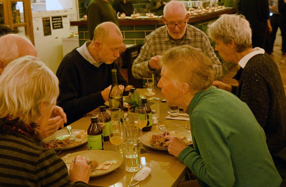 Diners enjoy the vegan upcycled meal at Kind Company.