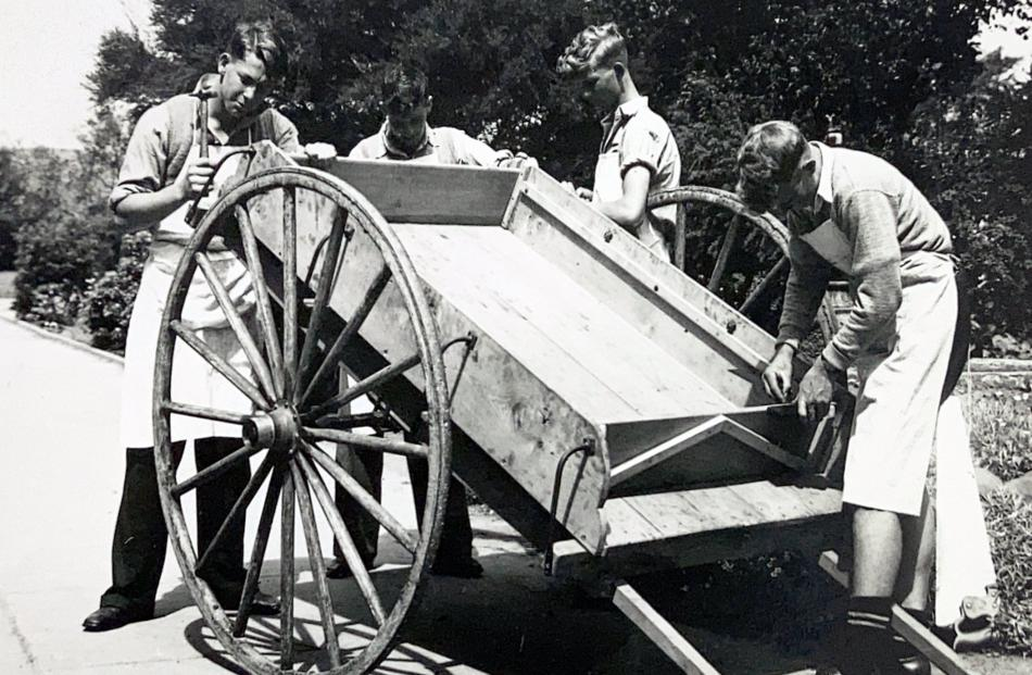 A farm cart made by rural pupils is given finishing touches (undated).PHOTO: TAIERI COLLEGE