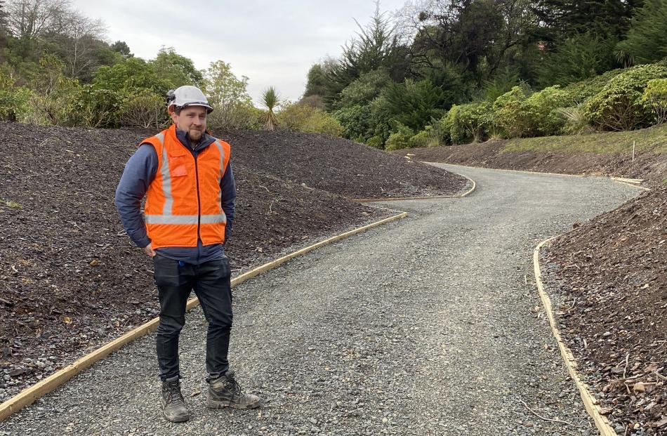 NZ Transport Agency senior project manager Jason Forbes stands on a section of shared pathway...