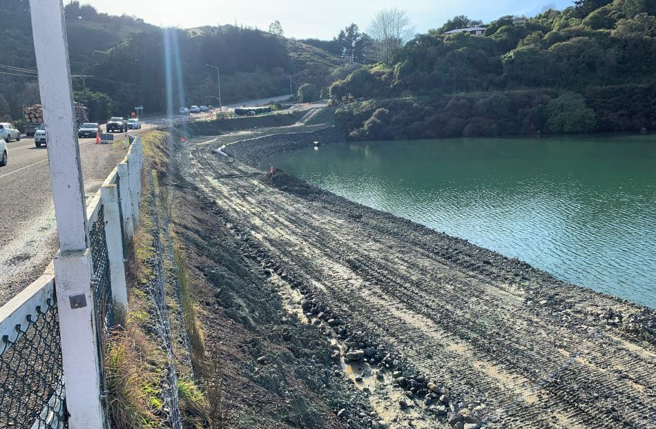 Reclamation continues at Blanket Bay to create ground  for the shared path. PHOTO: JASON FORBES