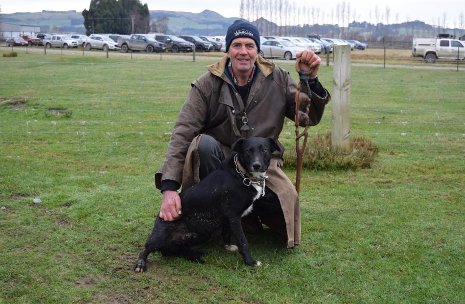George Broughton, of Otautau, pats heading dog Boss after selling him for $5000 at Charlton...
