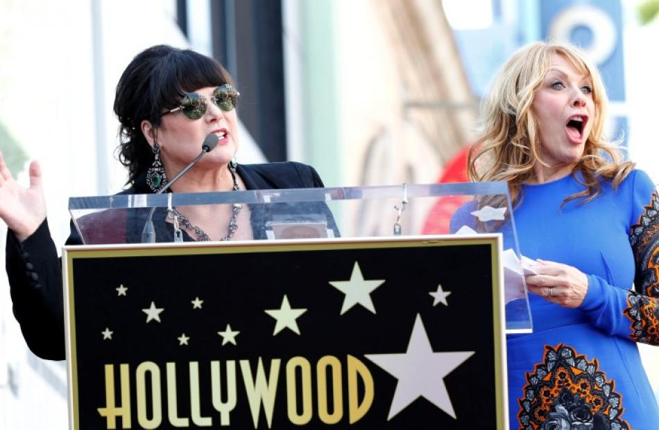 Ann (L) and Nancy Wilson of Rock band Heart attend the ceremony for the unveiling of their star...