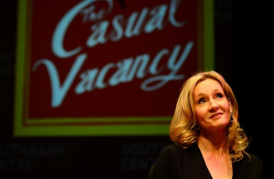 Author J.K. Rowling poses during an event to publicise her book 'The Casual Vacancy' at the Queen...