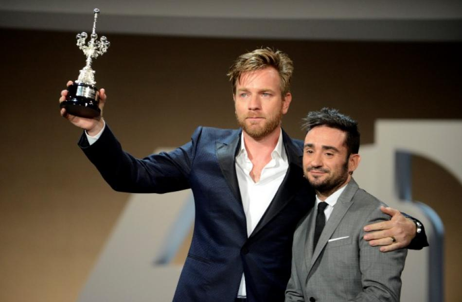 Scottish actor Ewan McGregor (L) hold up his Donostia Award For Lifetime Achievement presented to...