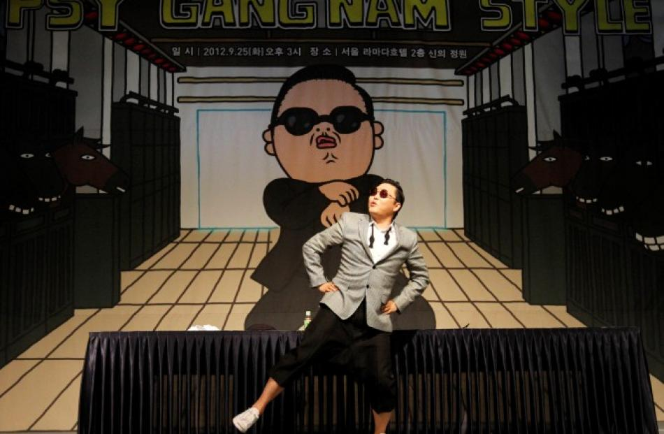 South Korean singer Psy dances after a news conference at a hotel in Seoul. REUTERS/Kim Hong-Ji