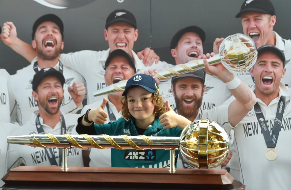 Giving two thumbs up behind the Mace trophy is Harris O'Sullivan (7), of Dunedin.PHOTO: PETER...