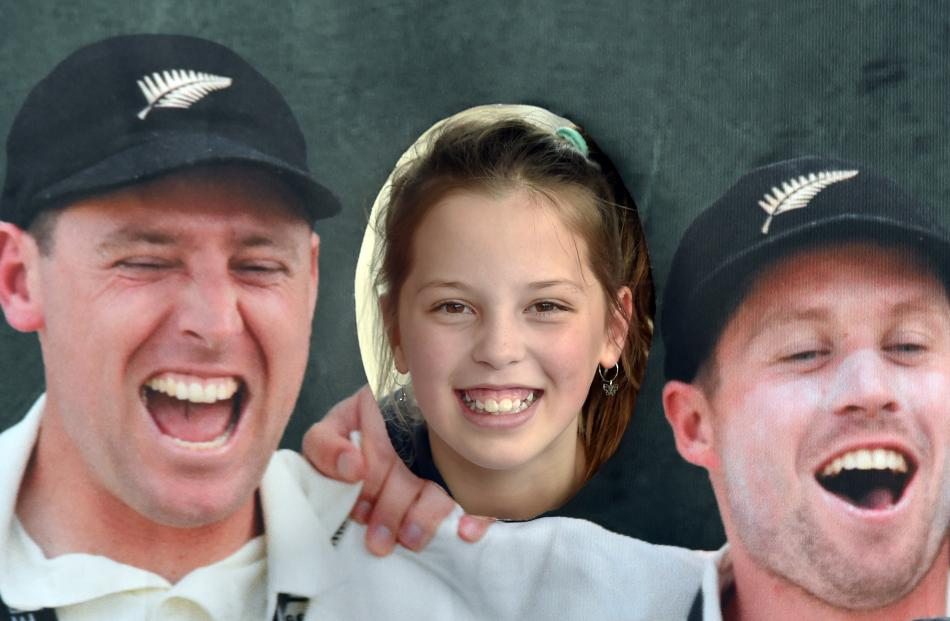 Posing in a cutout stand of the Black Caps team is Ora Winklemann (10), of Dunedin. PHOTO: PETER...