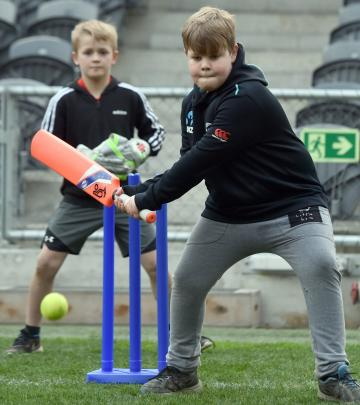 Taking a shot at the ball is Samuel McNabb (10), of Dunedin, while wicket-keeper Jake Gordon (8),...