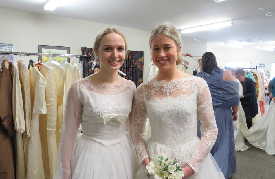 Brianna Sloper (left) and Milly Christie (both 16) wear wedding dresses back stage before...