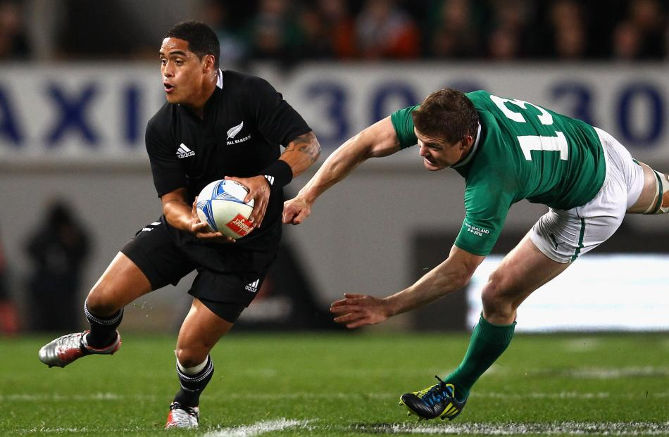Smith eludes the clutches of Irish great Brian O'Driscoll during the test at Eden Park in 2012.