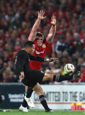 Aaron Smith kicks past Lions prop Tadhg Furlong during the first test at Eden Park in 2017....