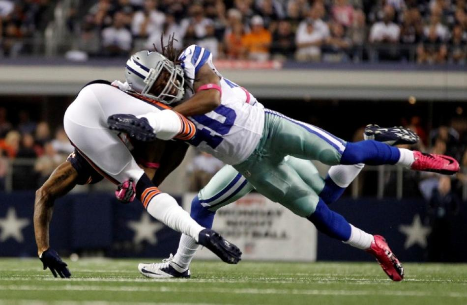 Chicago Bears wide receiver Brandon Marshall is tackled by Dallas Cowboys safety Danny McCray in...
