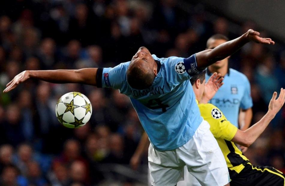 Manchester City's Vincent Kompany misses the ball during their Champions League Group D football...