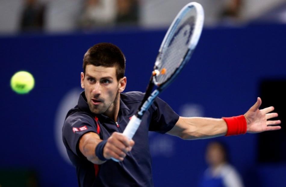 Serbia's Novak Djokovic hits a shot during his second round men's singles match against Argentina...