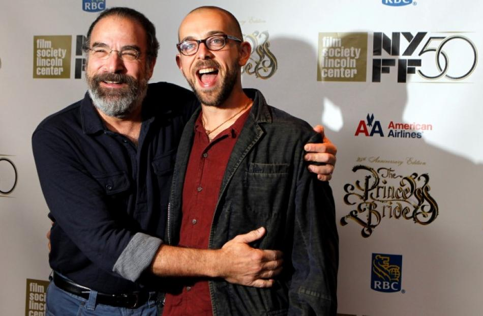'The Princess Bride' cast member Mandy Patinkin (L) arrives with his son Isaac for a special 25th...