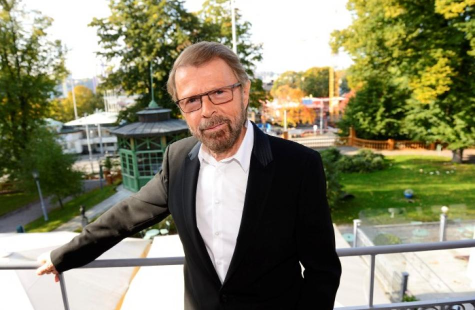 Former ABBA band member Bjorn Ulvaeus poses for photographers in front of a construction site for...