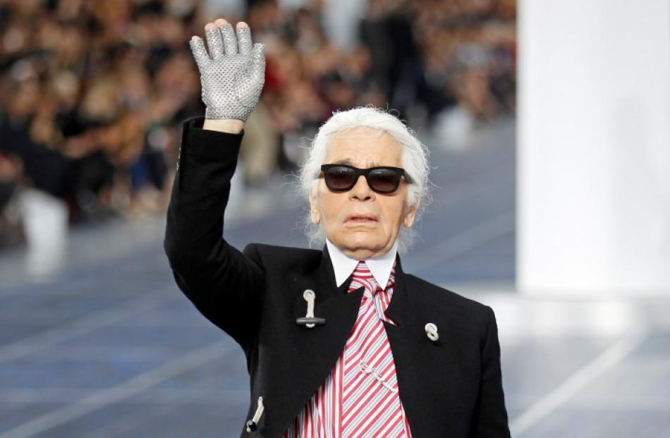 German designer Karl Lagerfeld appears at the end of his Spring/Summer 2013 women's ready-to-wear...