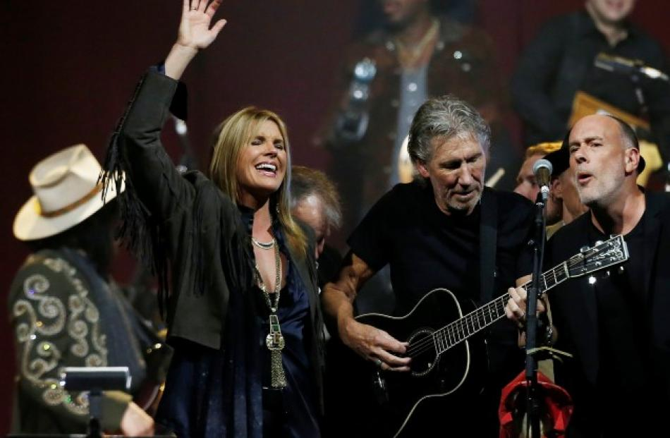 Musicians Grace Potter (L), Roger Waters (C) and Marc Cohn perform with other guests during the ...