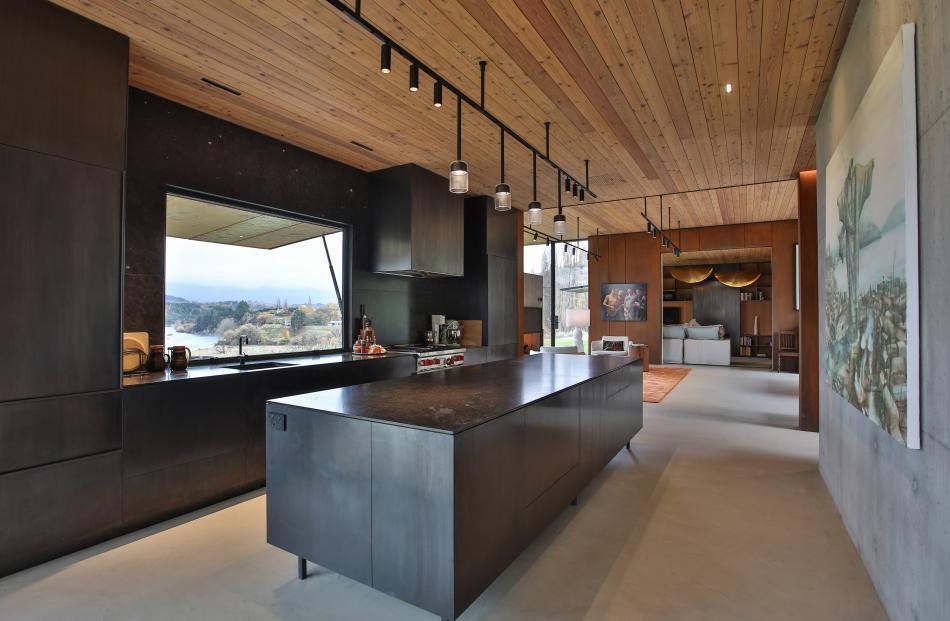 The large, minimalist-look kitchen.