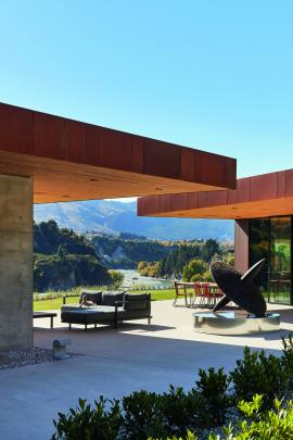 Large cantilevered roofs provide shade in summer.