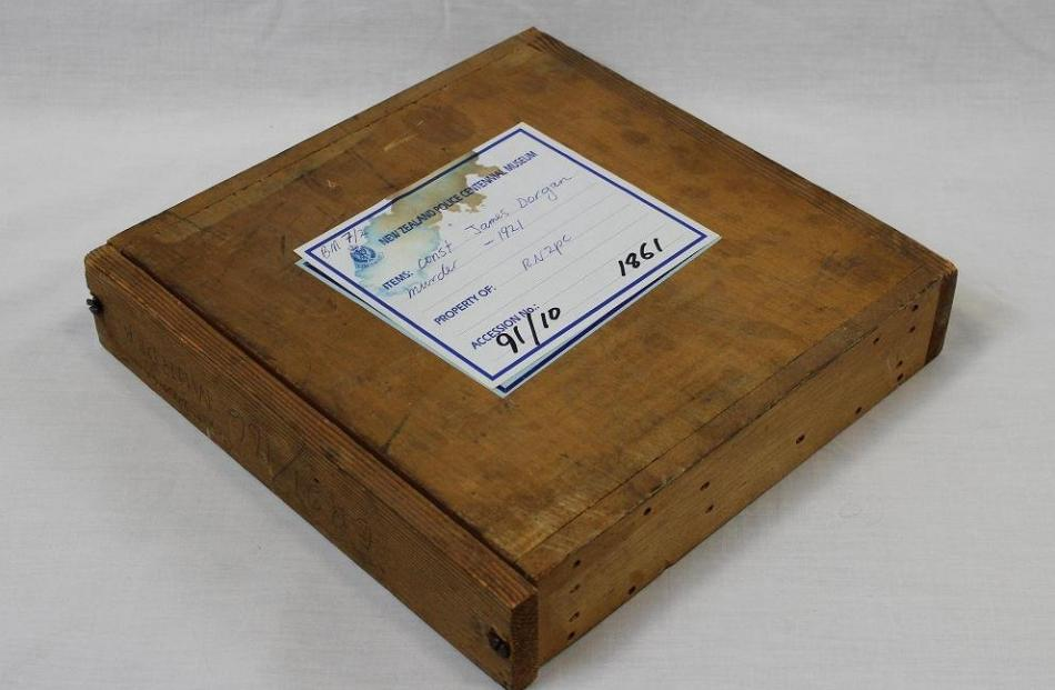 The sealed box containing a pane of glass with fingerprints of a suspect.