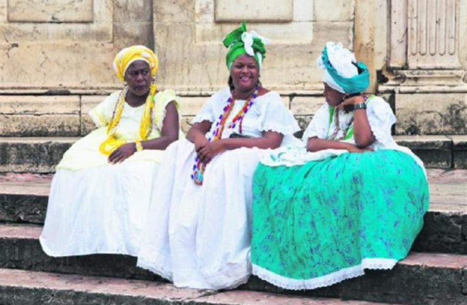 On the streets of Salvador the women wear big smiles and even bigger Bahian dresses.