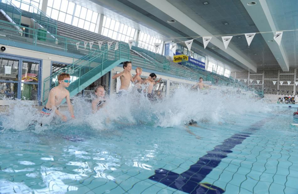 Choirboys take to the pool en masse.